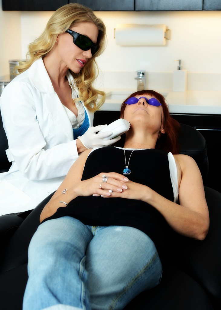 Woman receiving laser skin treatment in Marin County