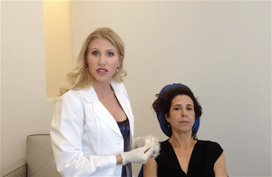 Dr. Karron Power discusses the best Botox and facial filler techniques with a patient.